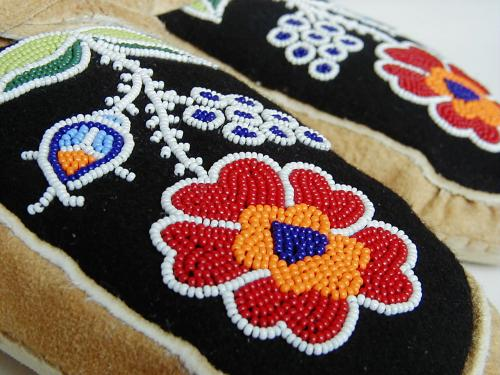 close up of beaded vamp on moccasins